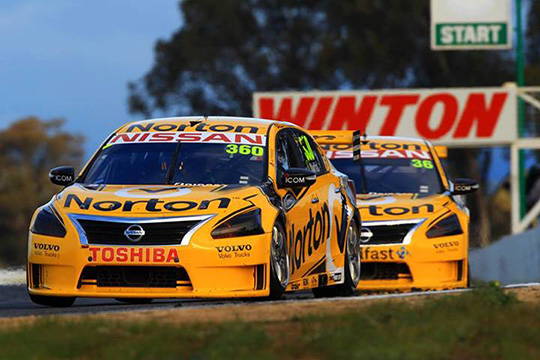James Moffat leads home team-mate Caruso for his and Nissan's maiden V8 Supercars victory