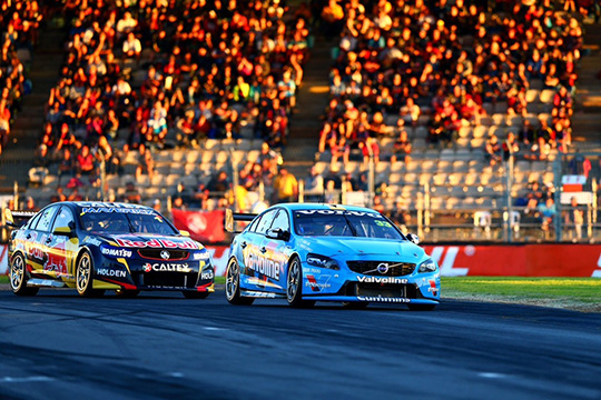 Scott McLaughlin and Jamie Whincup battle it out for second place in Race Two of the 2014 Clipsal 500 Adelaide