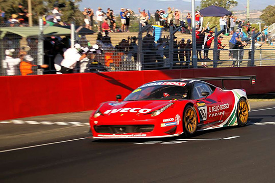 Craig Lowndes guides the Maranello Motorsport Ferrari 458 to the chequered flag at the Bathurst 12 Hour