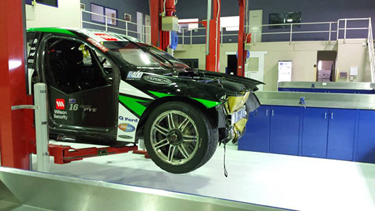 Scott Pye's Falcon under repair after the damage inflicted at the Sydney Motorsport Park 400