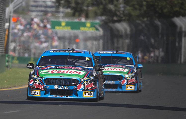 Mark Winterbottom leads Chaz Mostert at Albert Park. Photo by Rhys Vandersyde