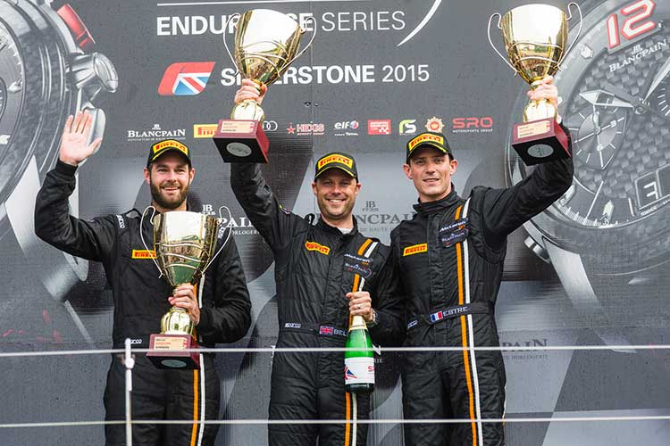 Shane van Gisbergen on the podium with team-mates Rob Bell and Kevin Estre at Silverstone
