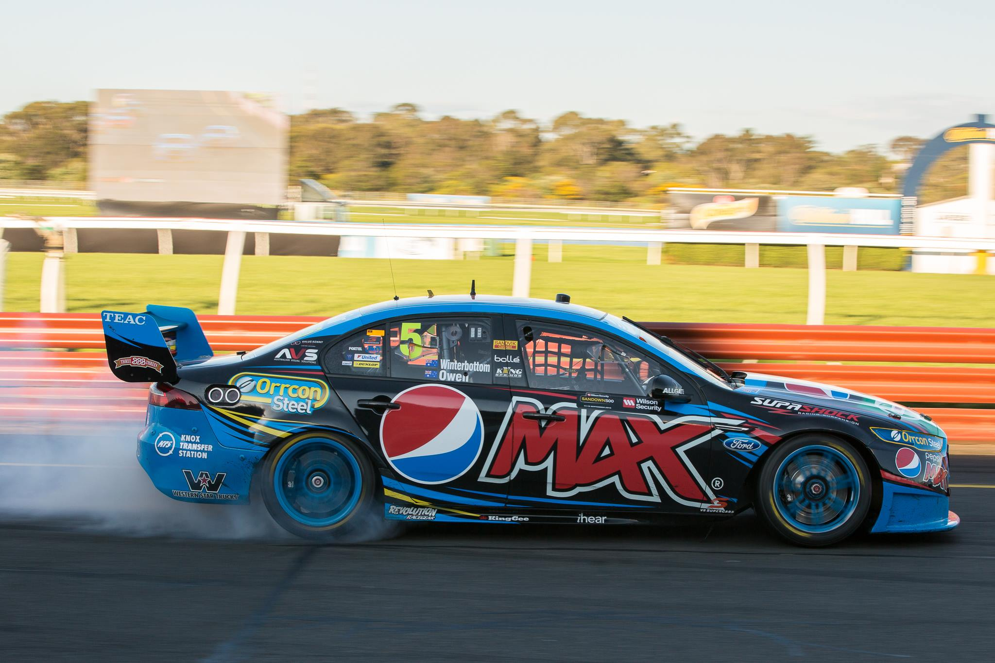 Mark Winterbottom celebrating his Sandown 500 win with a $3000 burnout. Photo by Rhys Vandersyde