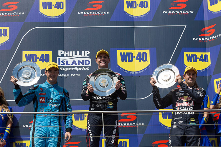 Craig Lowndes on the top step at Phillip Island