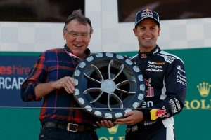 Larry Perkins and Jamie Whincup with the Larry Perkins Trophy